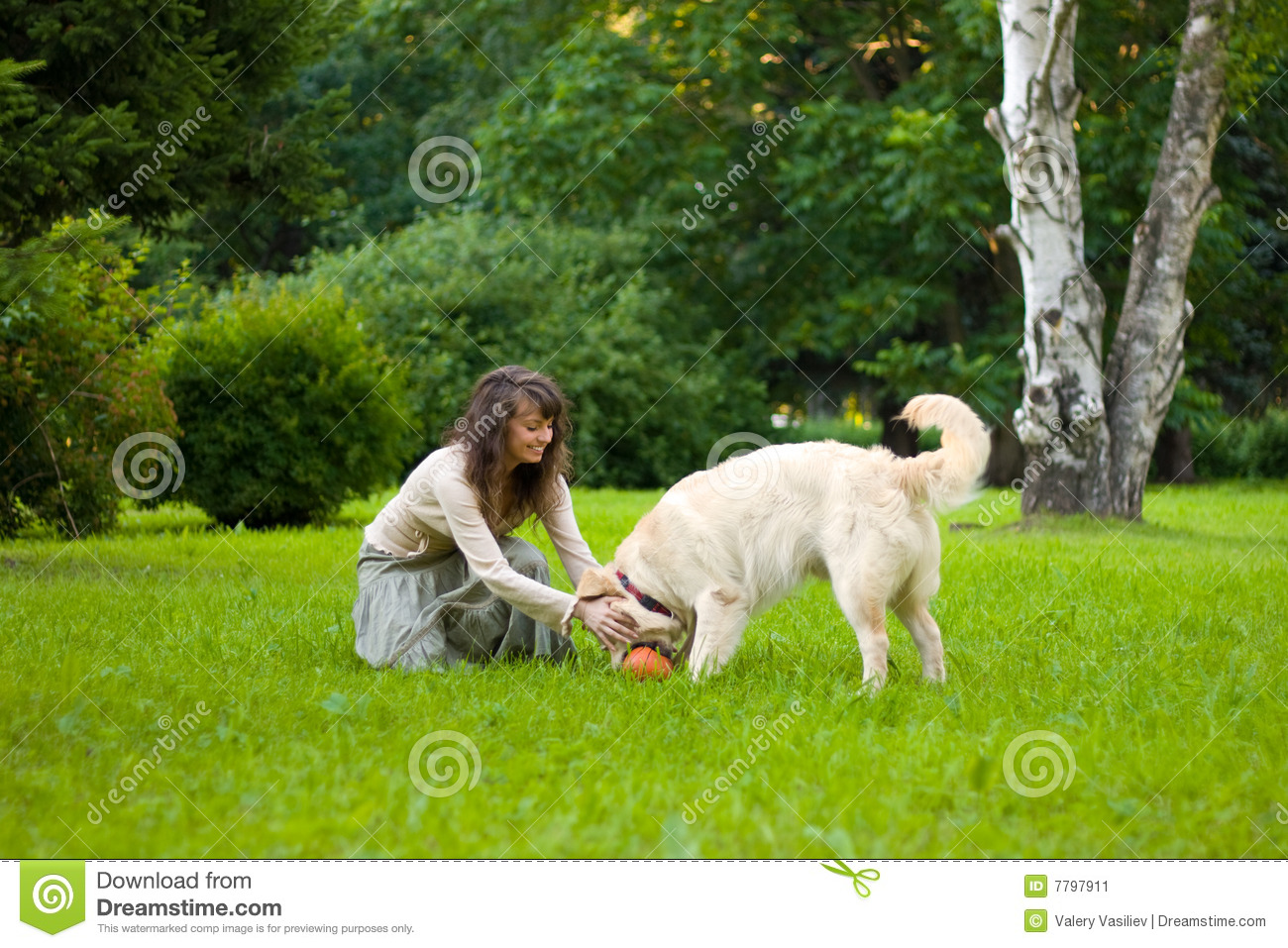 Girl plays ball with a dog