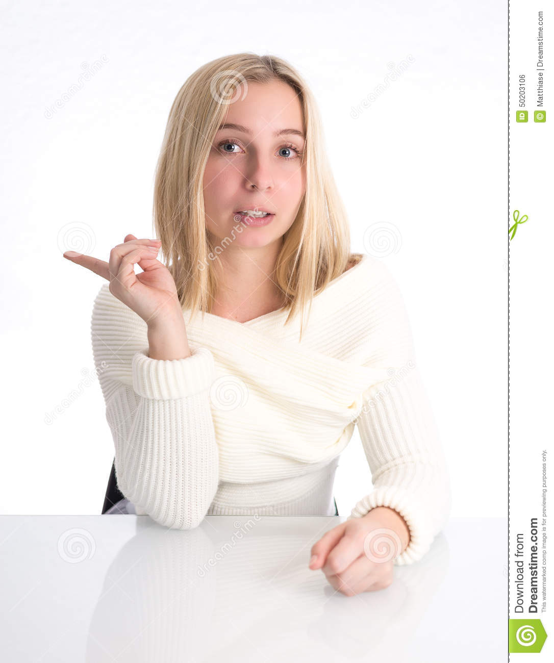 Girl pointing to her side