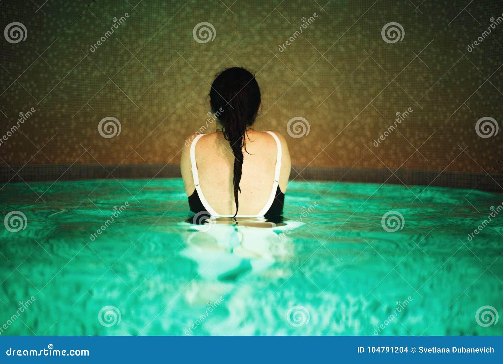 Girl in the pool backs