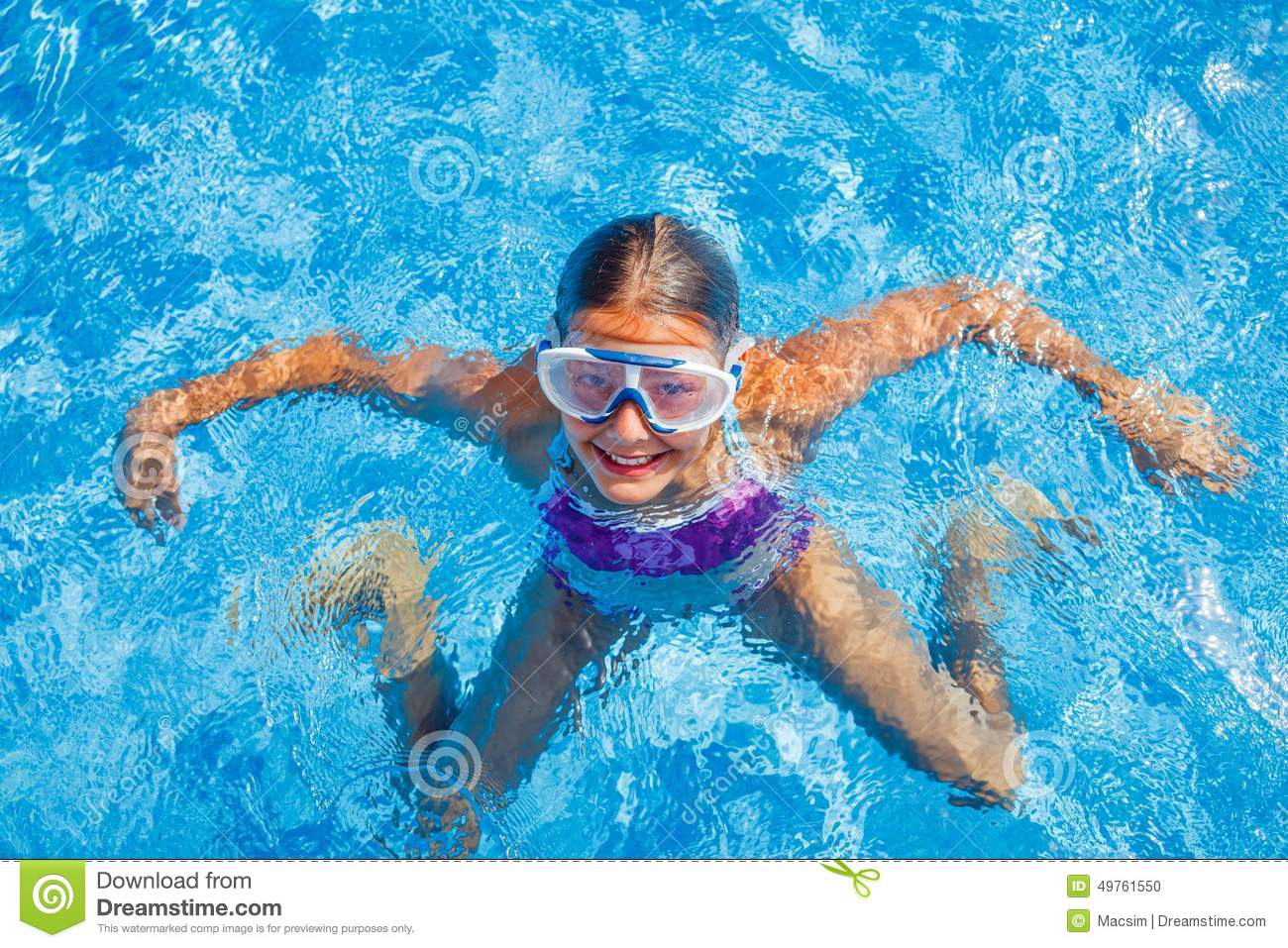 09c9c2af0ec Cute happy young girl in goggles swimming and snorking in the swimming pool