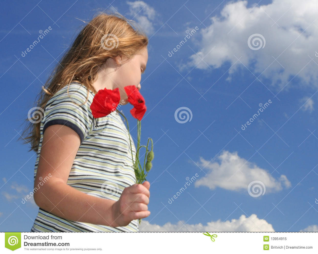Girl with poppies over sky