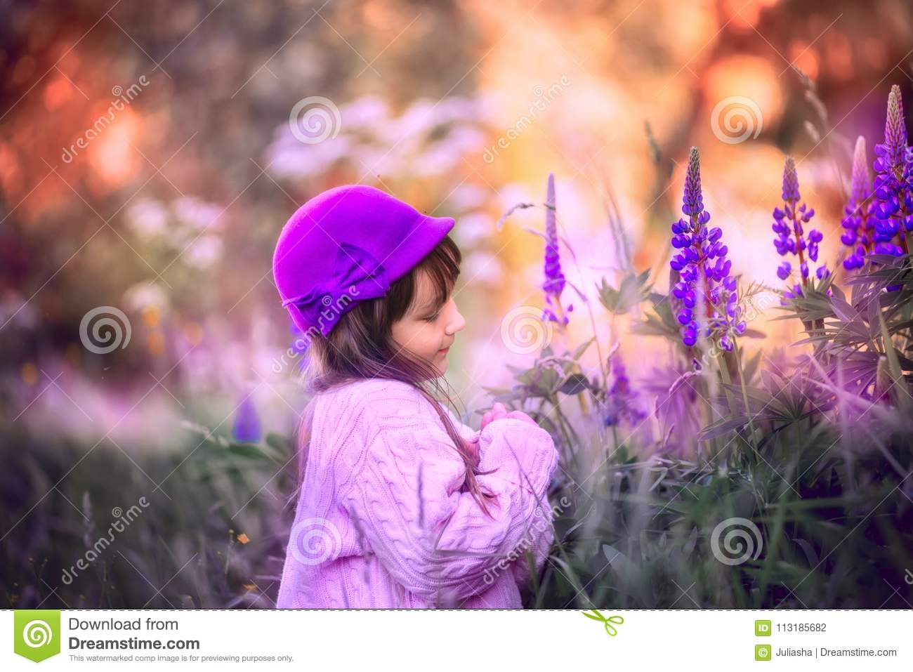 Girl portrait with lupine flowers