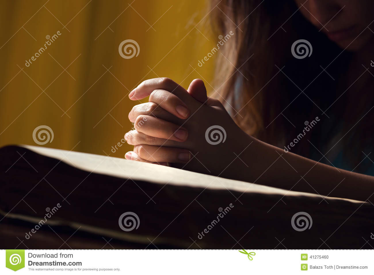 Girl Praying With Hands On Bible Stock Photo - Image: 41275460