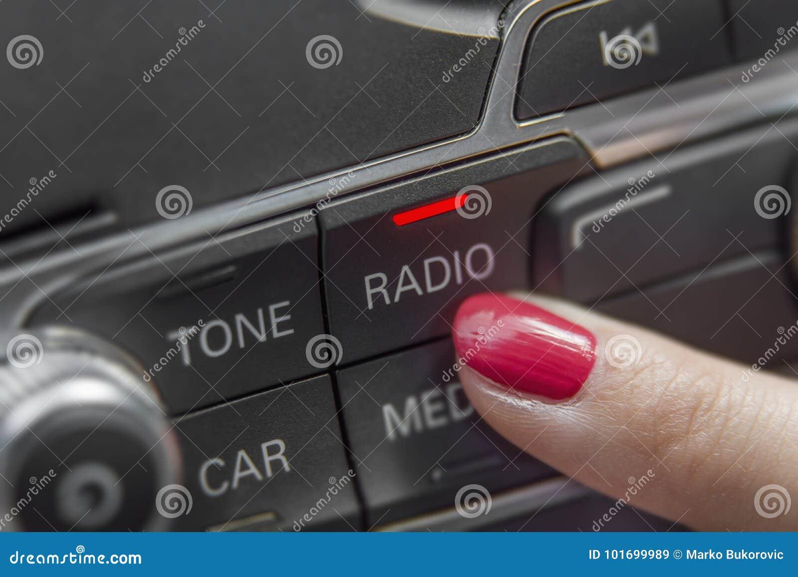 Girl pressing car radio stereo panel and modern dashboard equipment