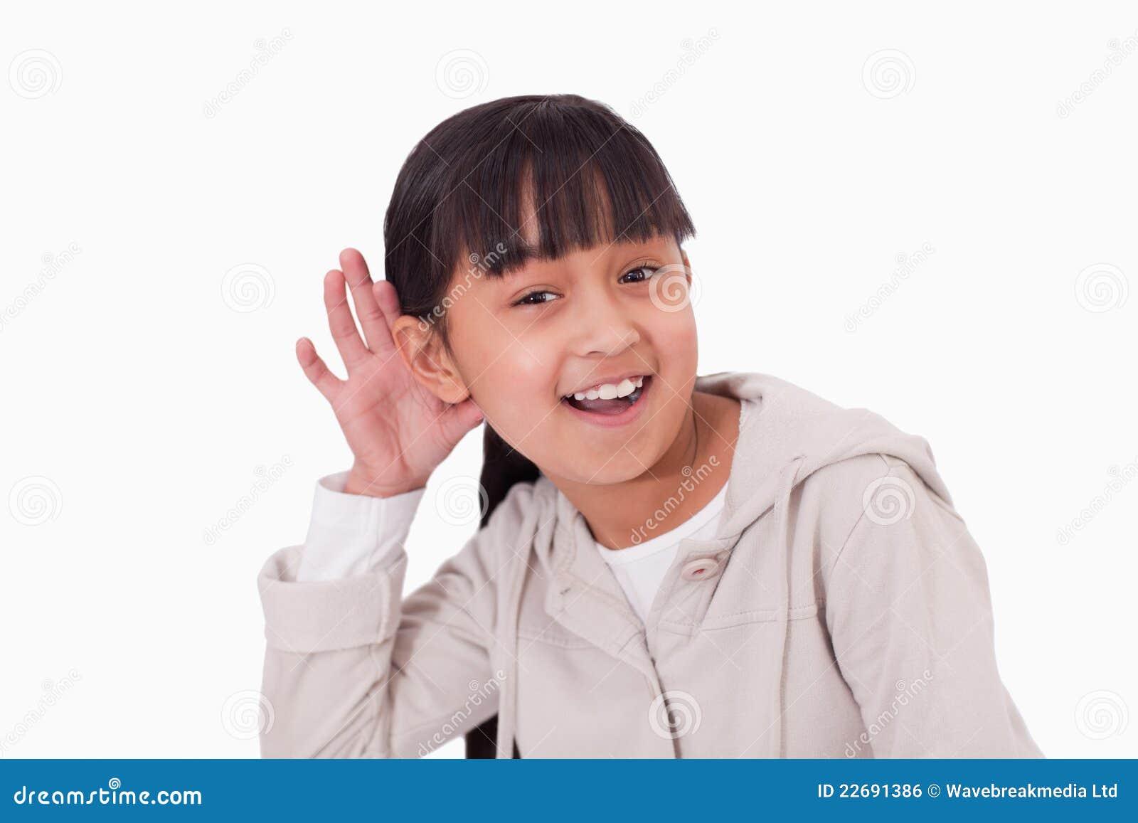 Girl pricking up her ear