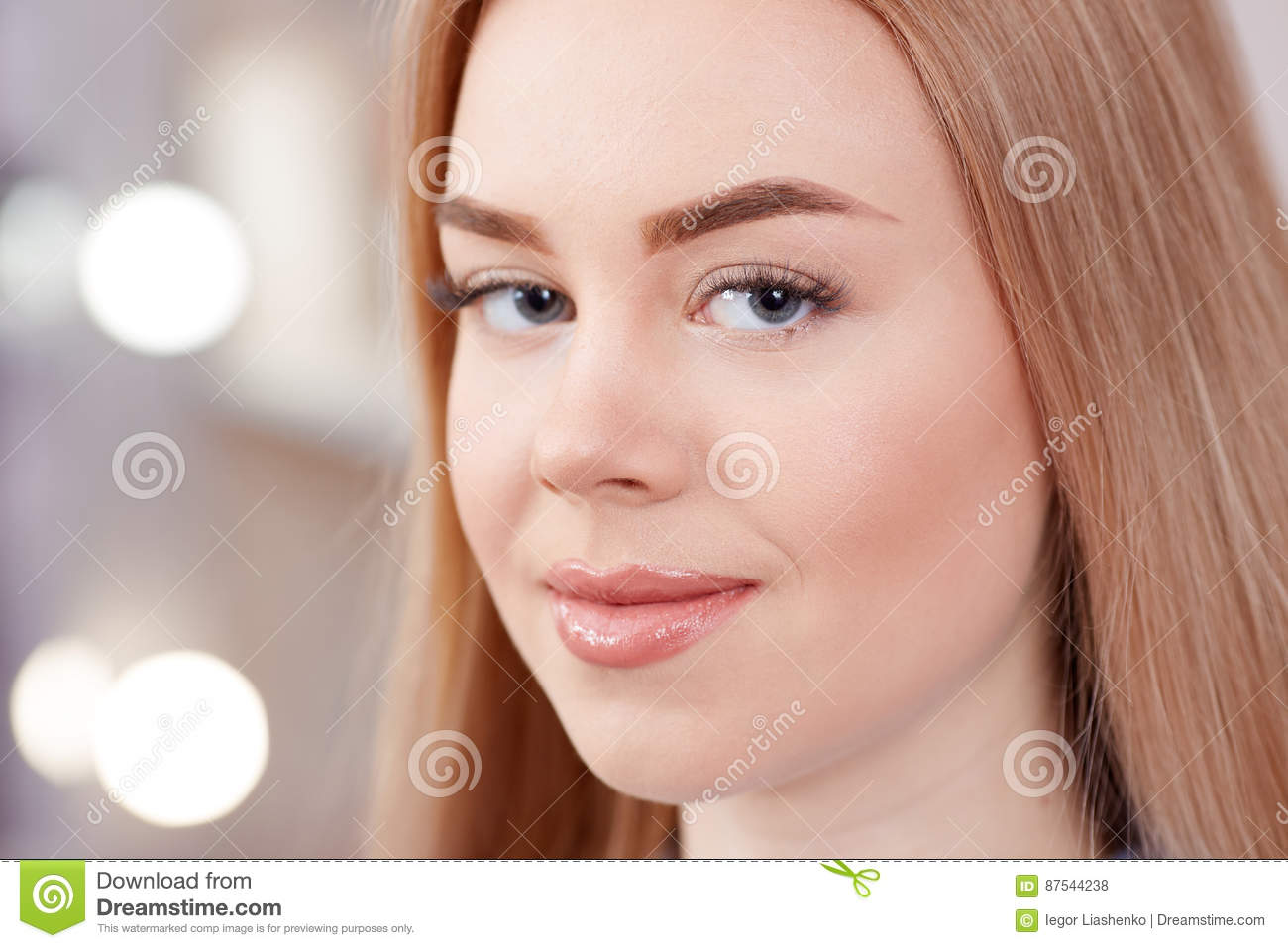 Girl After Procedure Of Permanent Makeup Of Eyebrows Stock Photo