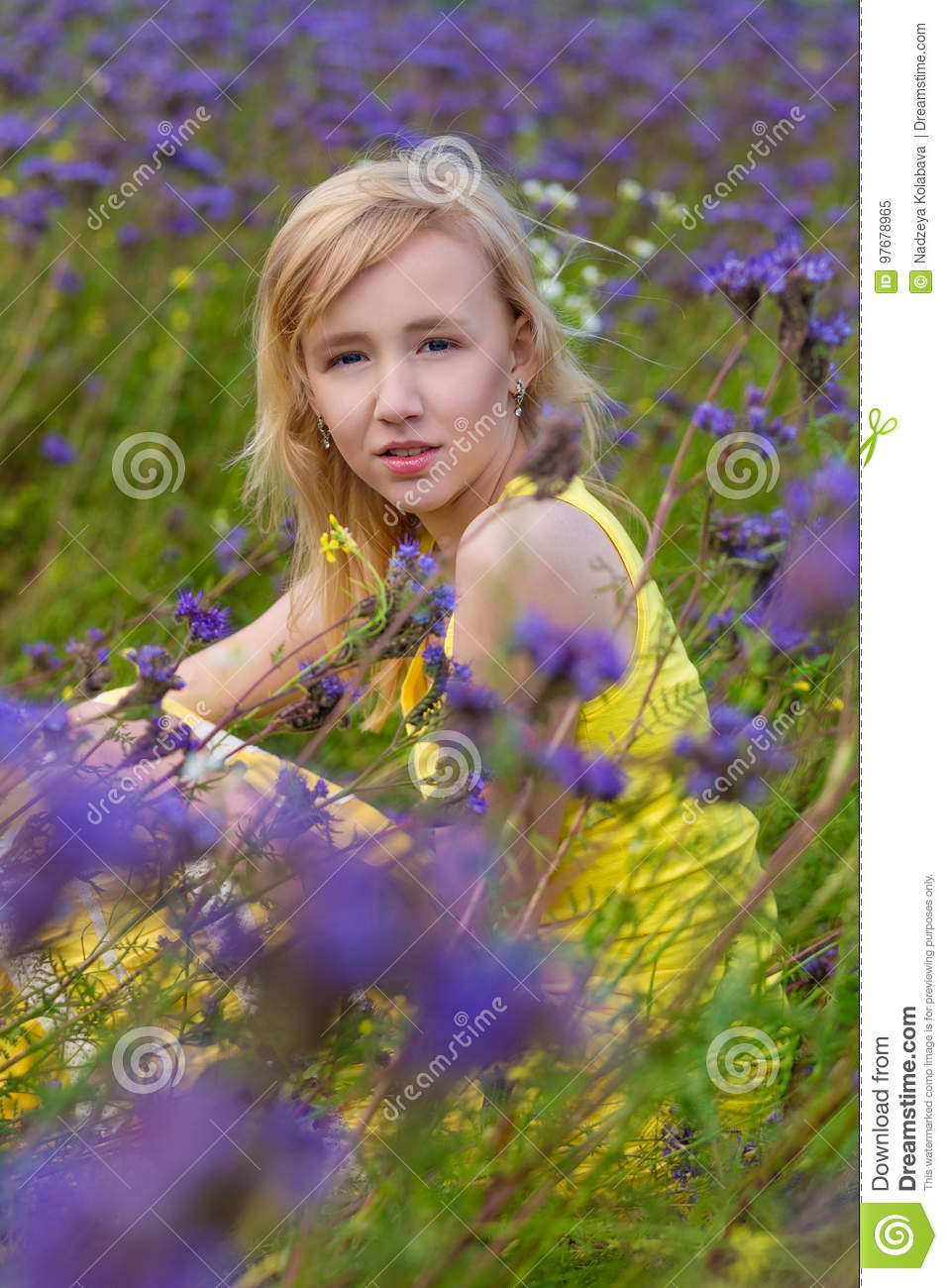 Girl in purple flowers outdoors in summer stock image image of beautiful young girl in a yellow dress in a blooming summer field girl in purple flowers outdoors in summer mightylinksfo