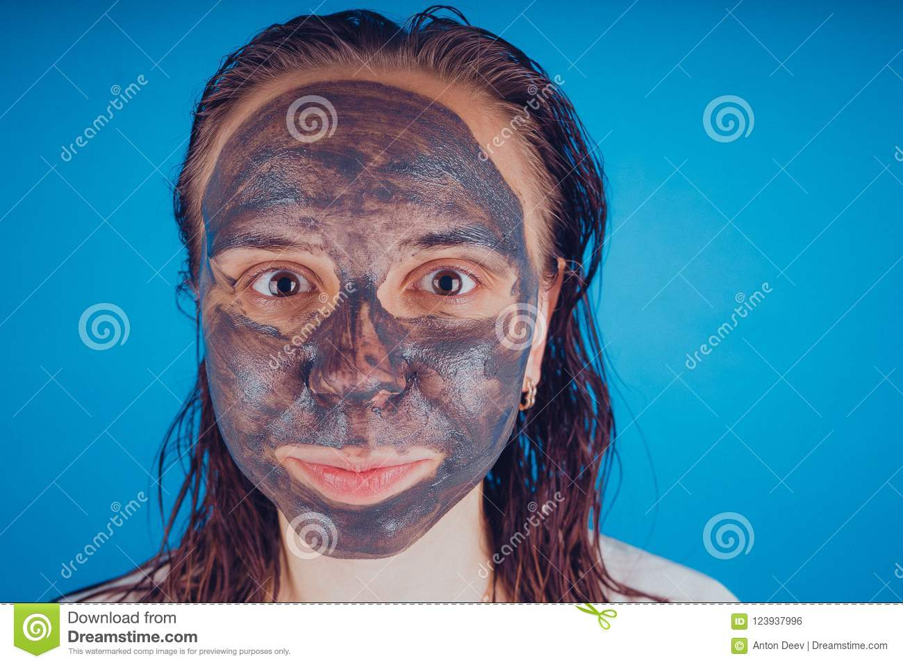 The girl put on the face mask for acne. The concept of facial