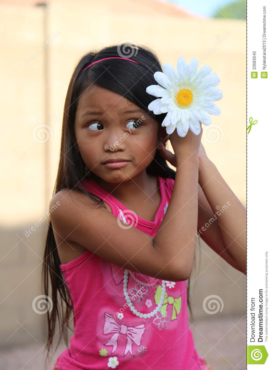 Girl Putting Daisy Flower In Hair Stock Photo Image Of Adorable