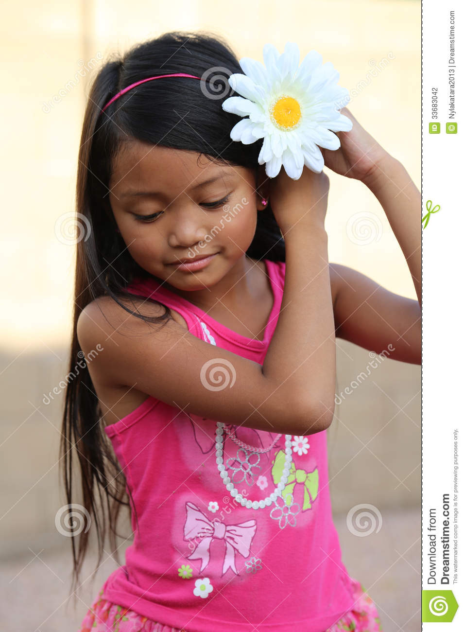 Girl Putting Flower In Hair Stock Photo Image Of Stem Day 33683042