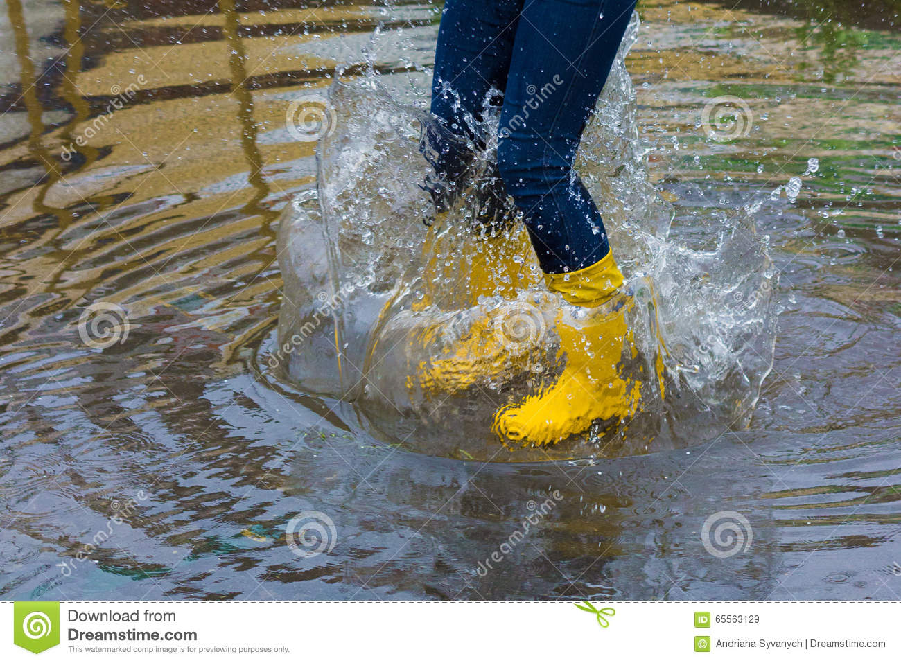 Girl With Rain Boots Jumps Into A Puddle Stock Photo - Image: 65563129