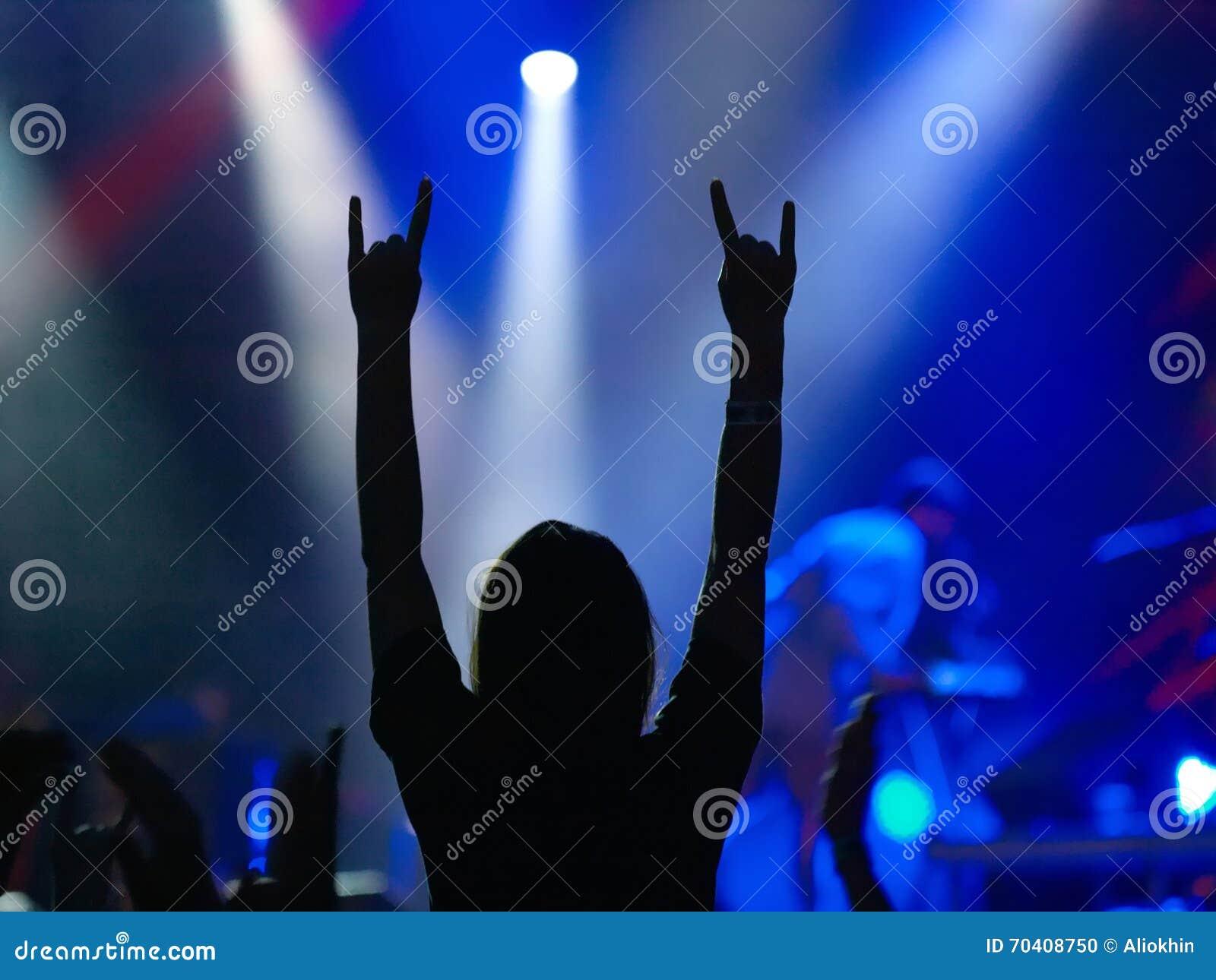 Pics photos rock concert background - Girl Raising Up Hands On Rock Concert Stock Photo