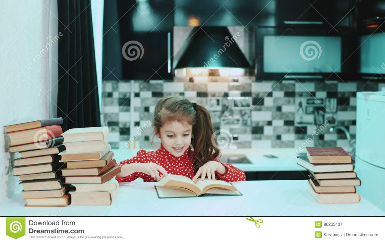 Girl Reading A Book In The Kitchen. Fast Play. Timelapse. Stock ...