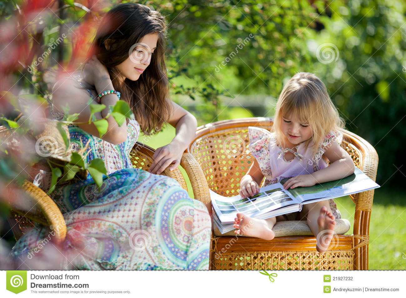 Girl Reading Book Sitting In Wicker Chairs Outdoor Stock