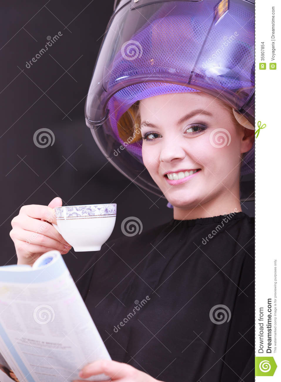 Girl reading magazine drinking coffee hairdryer in hair for Salon younga