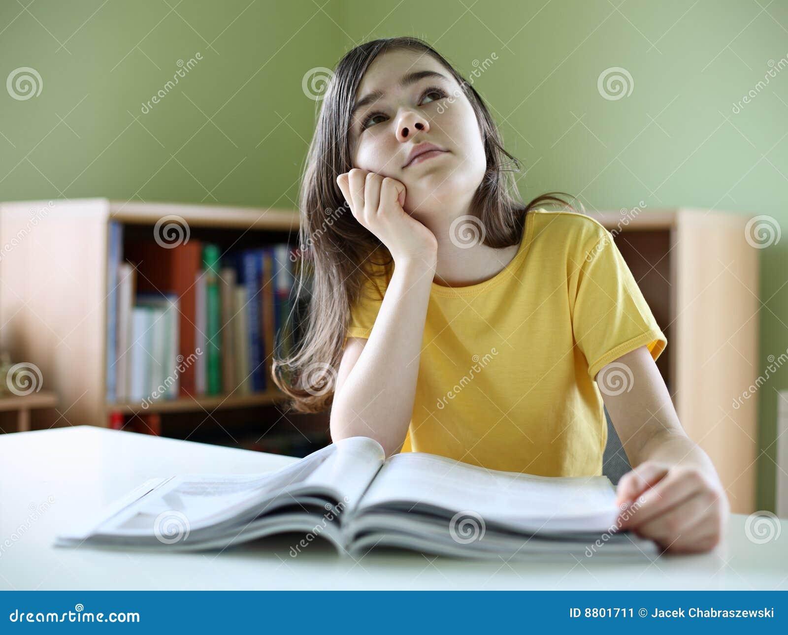 Girl reading magazines