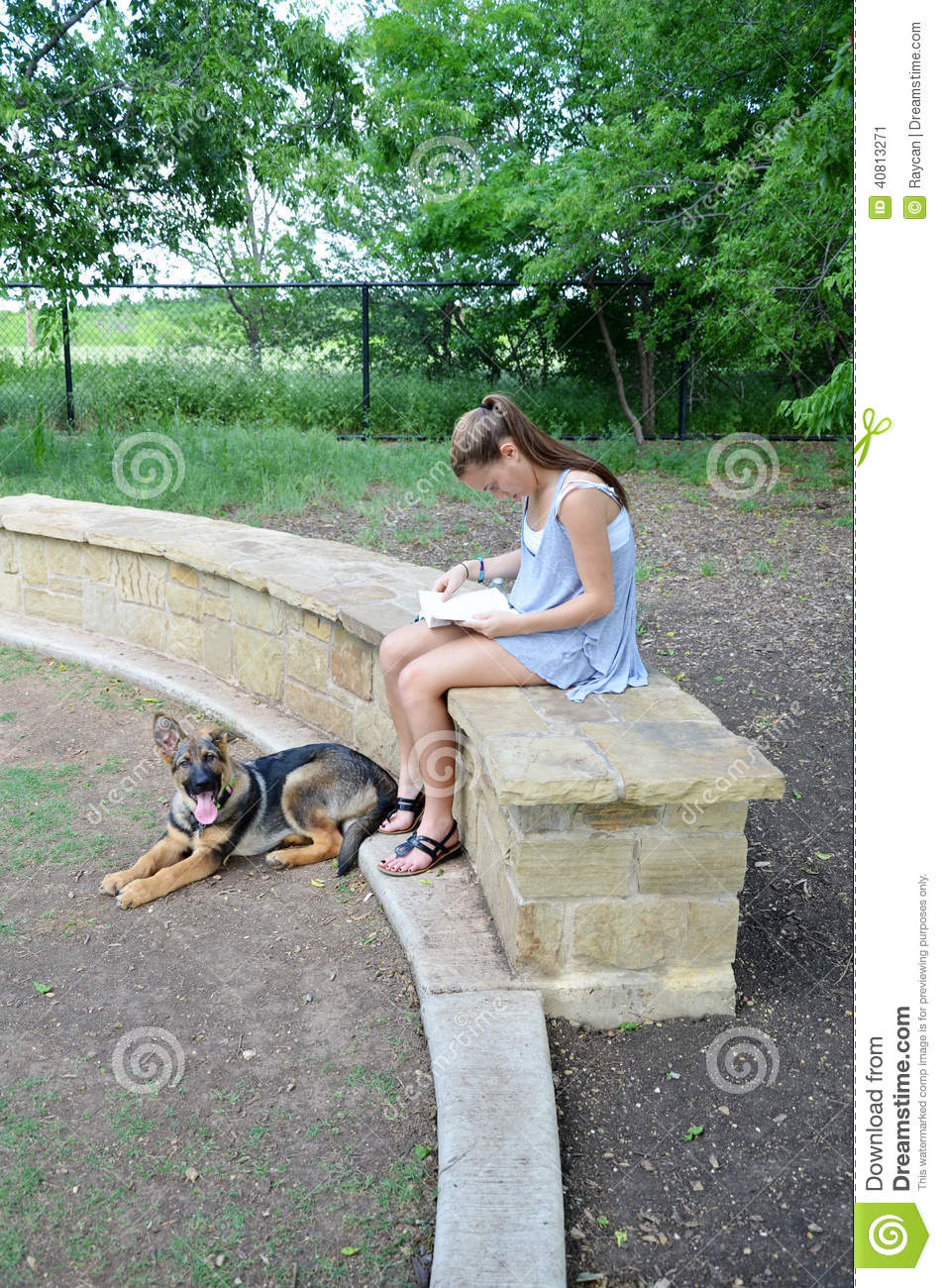 Girl Reading in Park with Dog