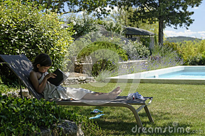 Girl on a recliner reading stock photo image 42362689 for Garden pool book