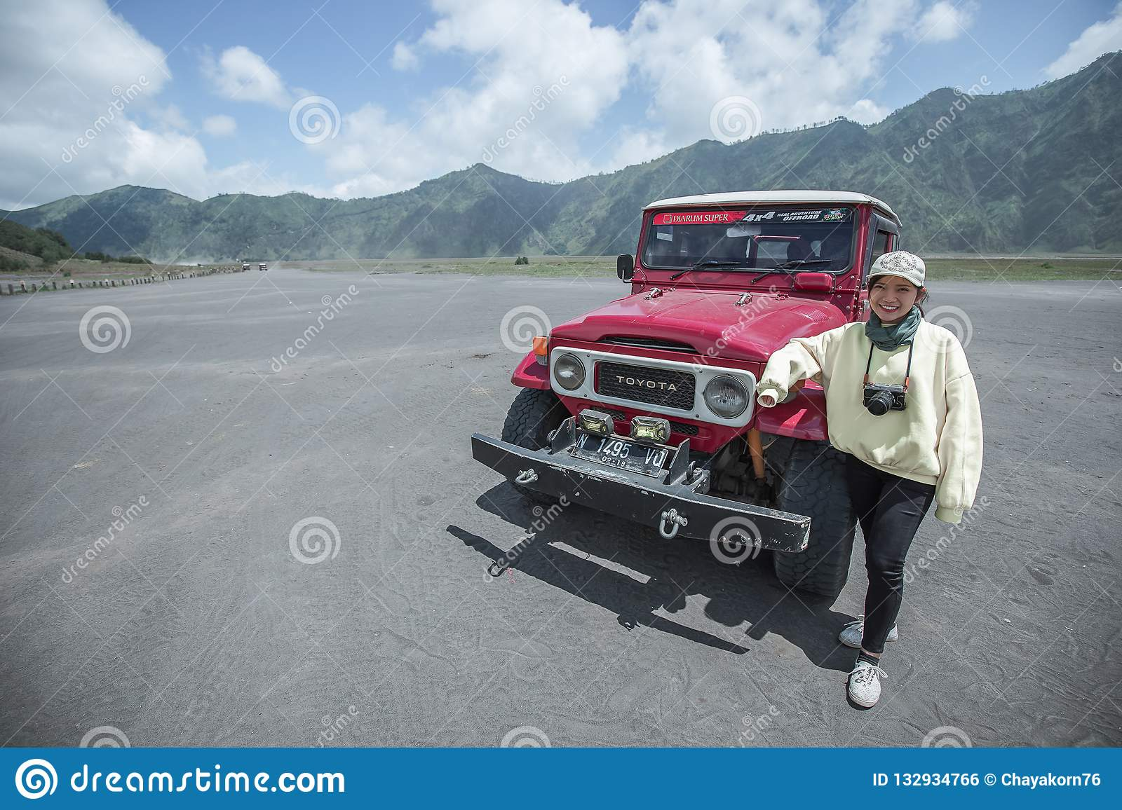 Girl with red 4x4 car editorial photo  Image of java - 132934766