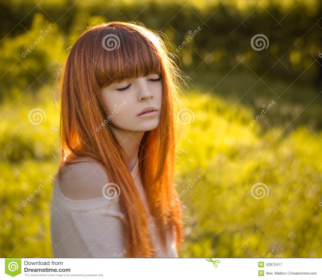 Girl with red hair in the forest