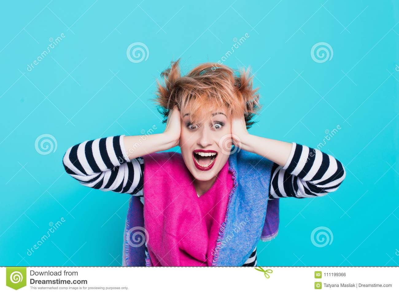 Girl with red hair holding her head shouting. Stress and hysterical. negative emotions. Studio shot.