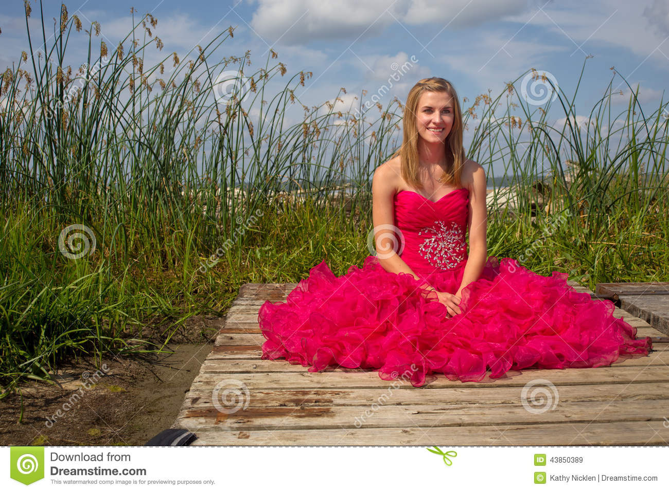 Girl Red Prom Dress Sitting On Dock Stock Photo Image