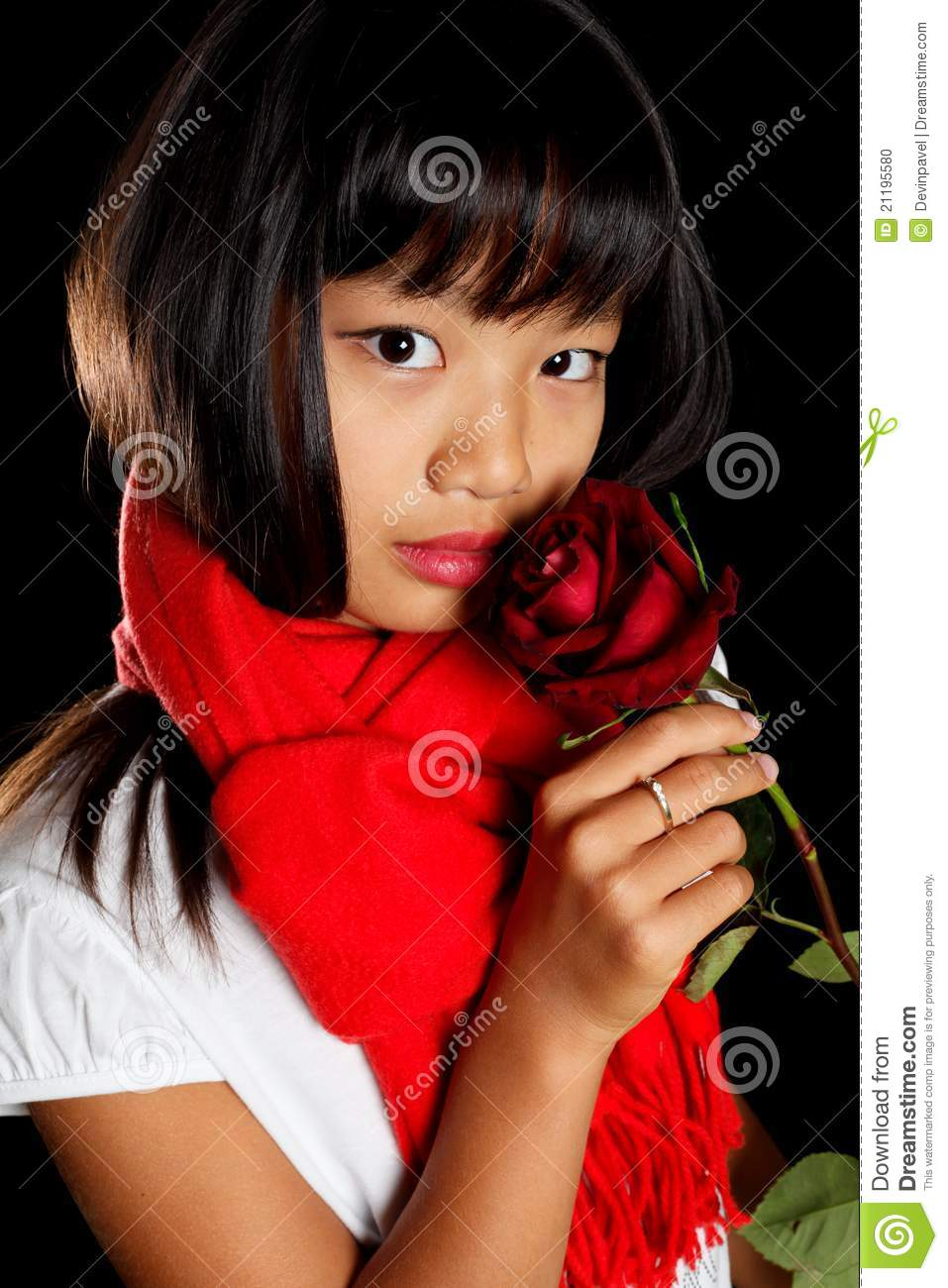 Girl in a red scarf with a rose