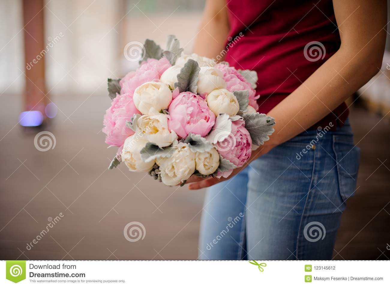 Girl holding bouquet of pink and champagne color peonies