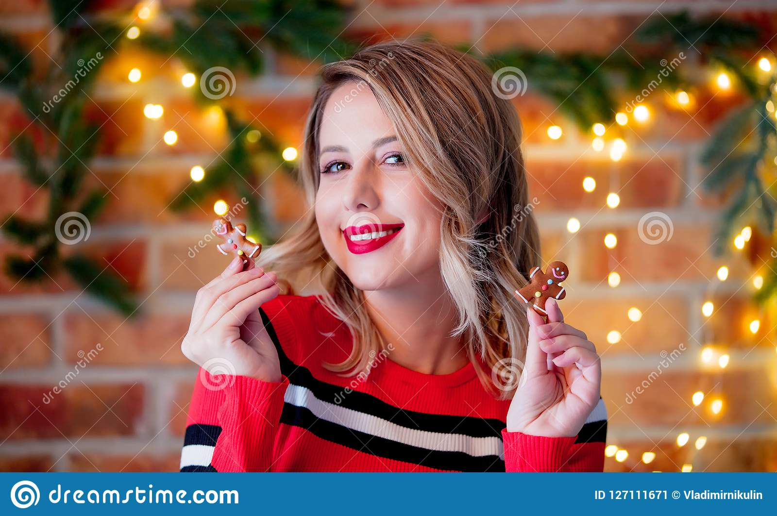 Girl in red striped sweater with gingerbread man