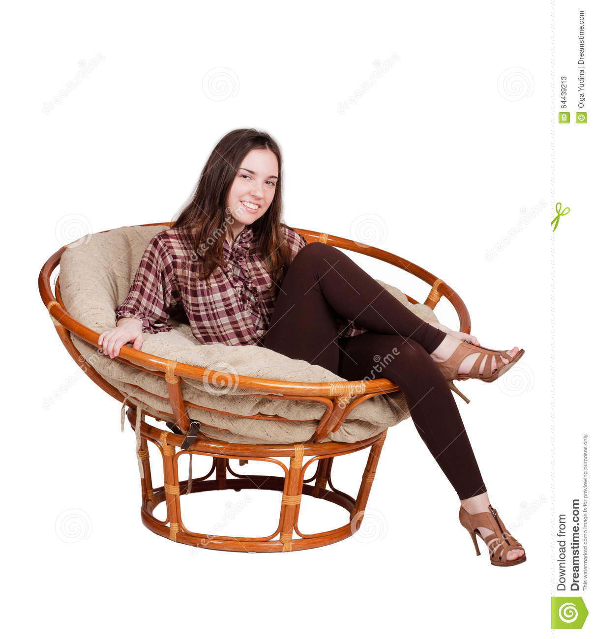 Merveilleux Girl Relaxes In A Papasan Chair Isolated On White