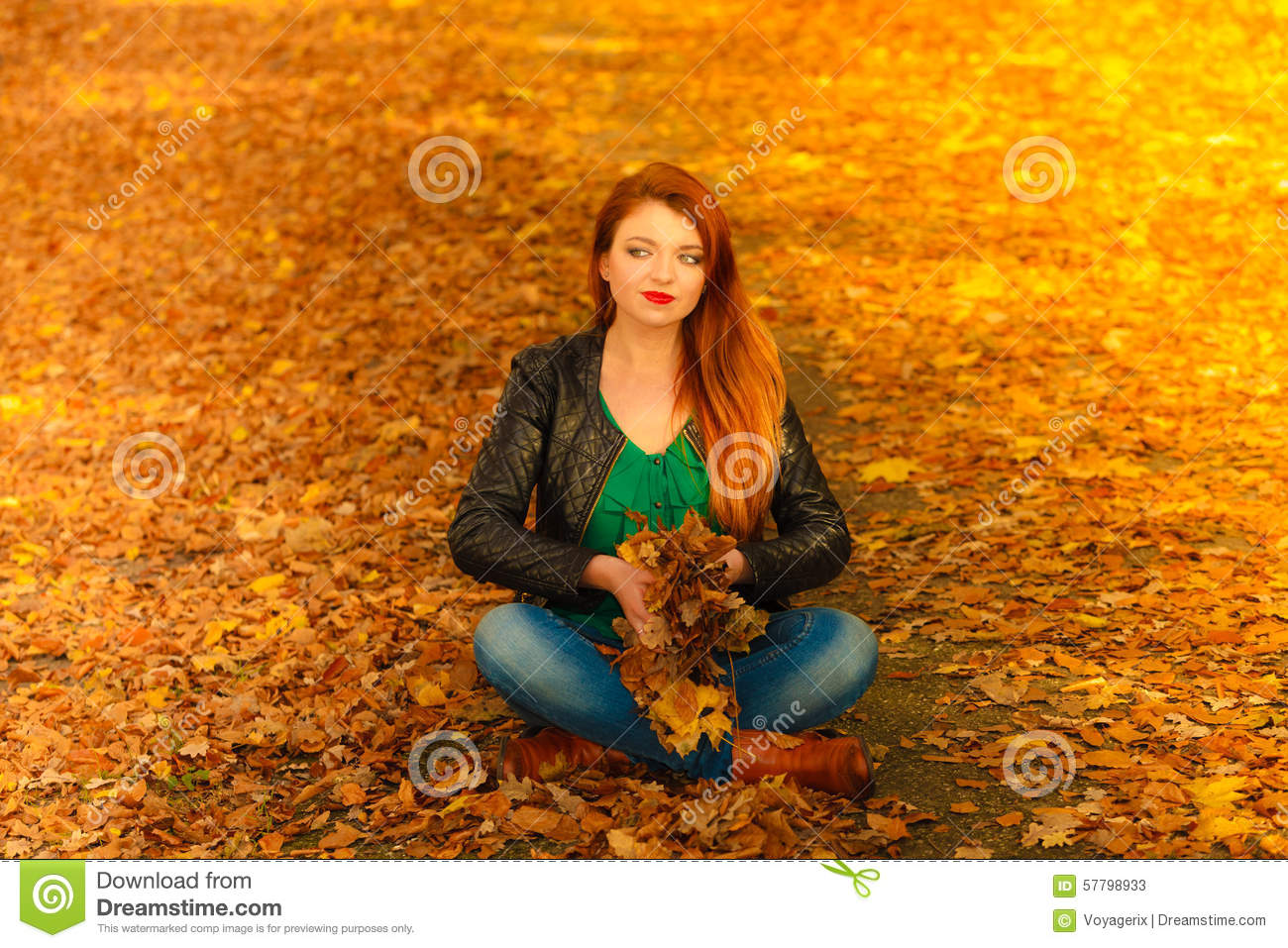 Girl Relaxing In Autumn Park Throwing Leaves Up In The Air ...