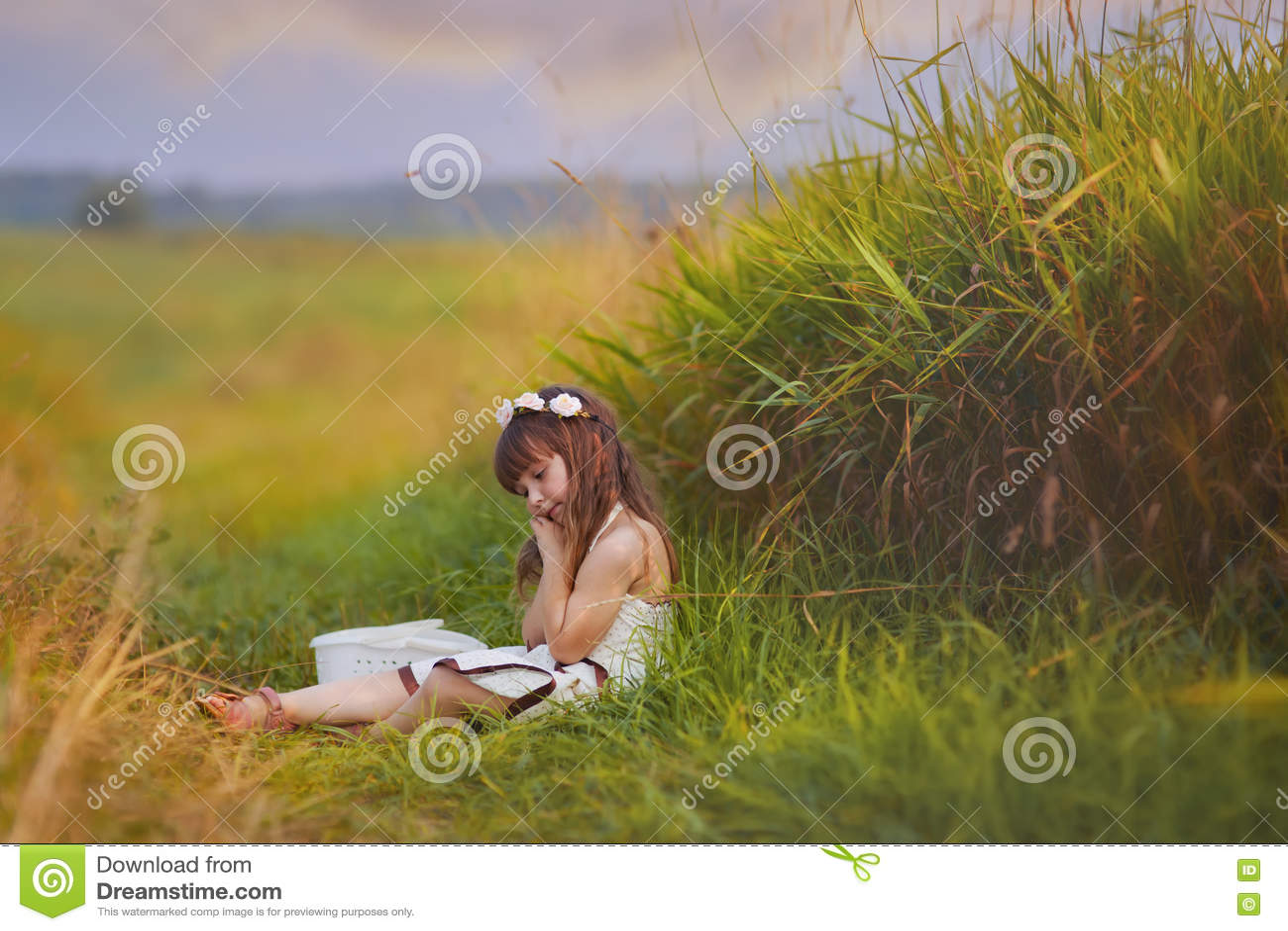 Girl relaxing in grass