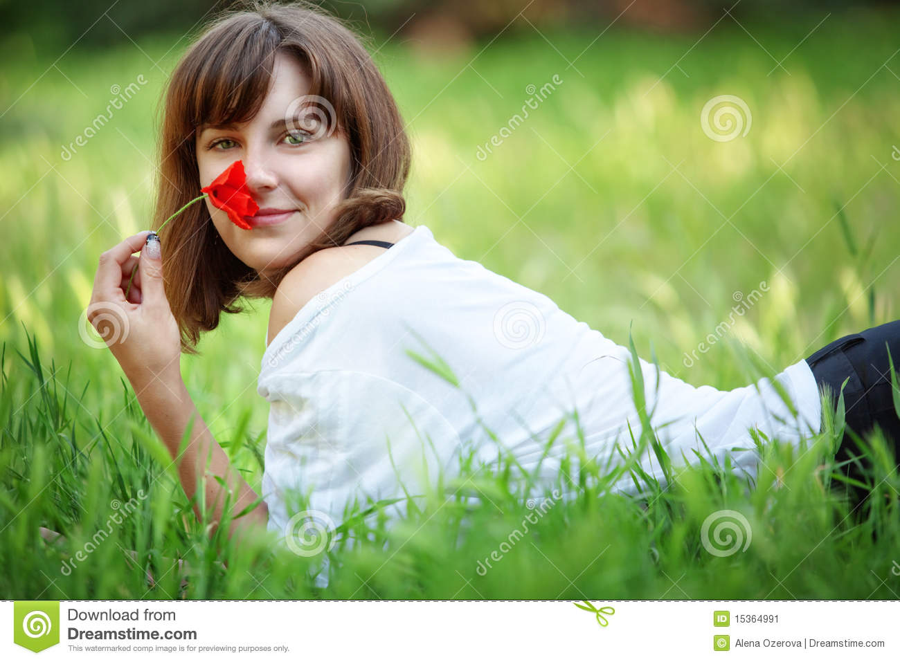 Attractive Woman Laying On The Grass Stock Image - Image