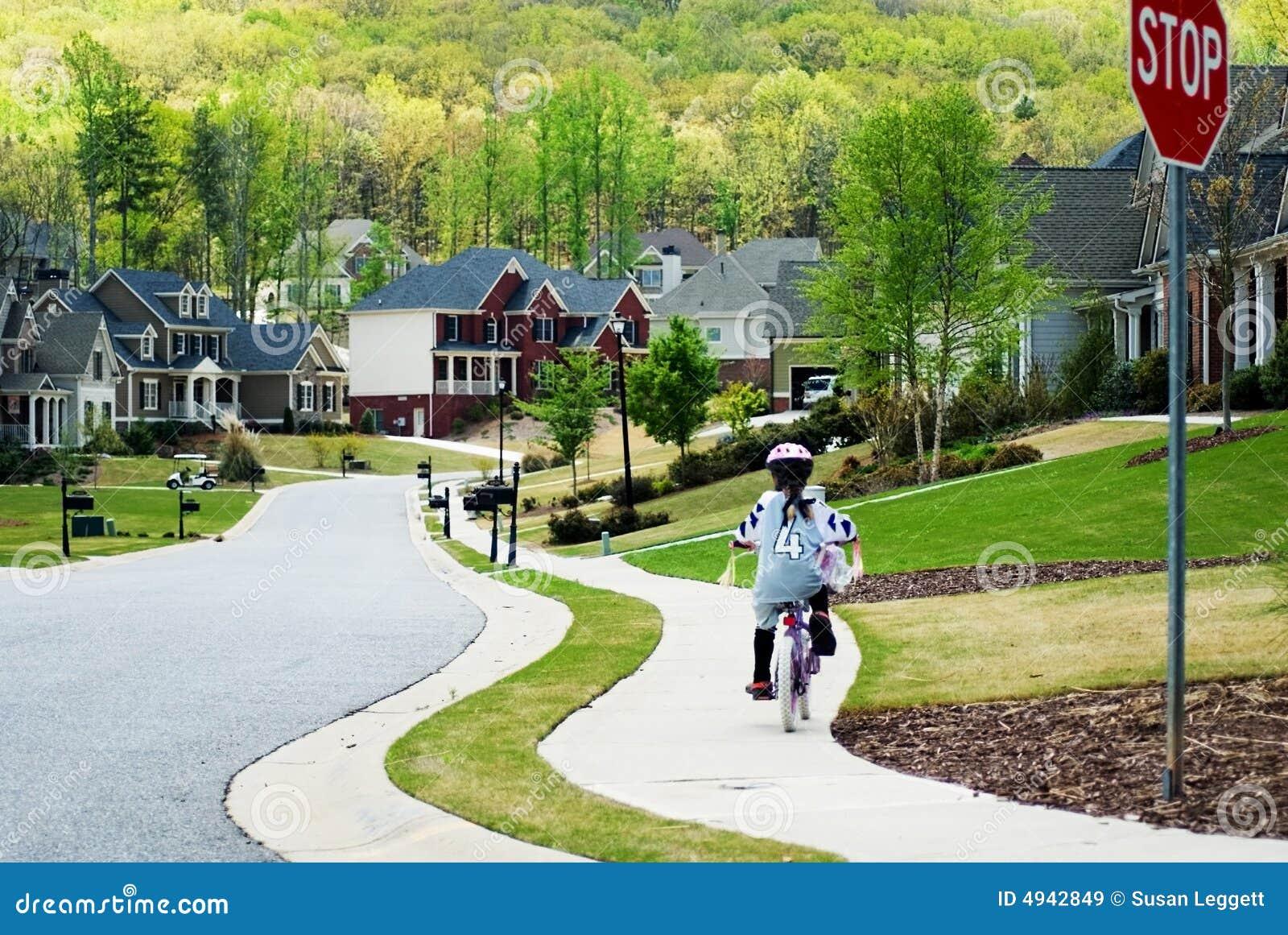 Girl Riding Bike Home
