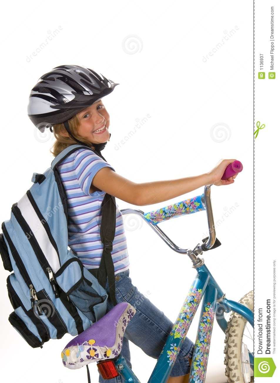 Young Girl Riding Bike
