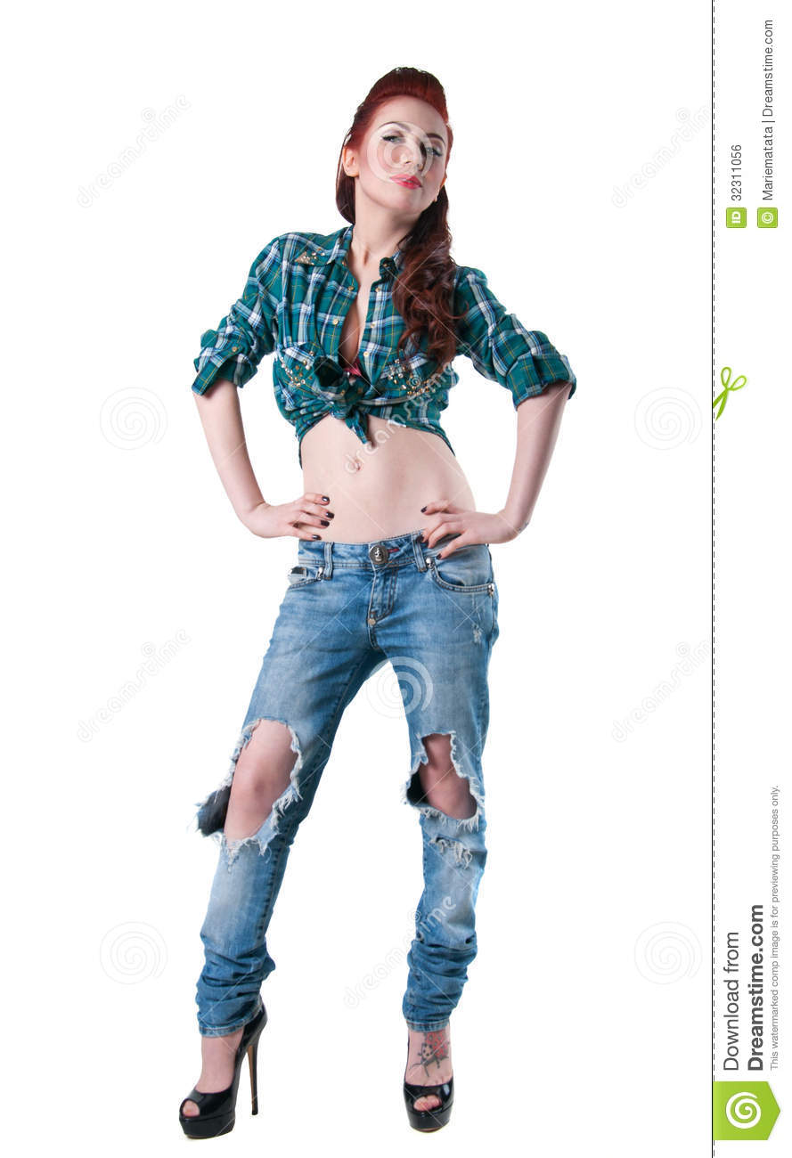 d280ce6ab38 Pretty woman model with long legs, wearing green checked shirt, ripped blue  jeans, black high heels, standing, legs crossed, hands in pockets, smiling,  ...