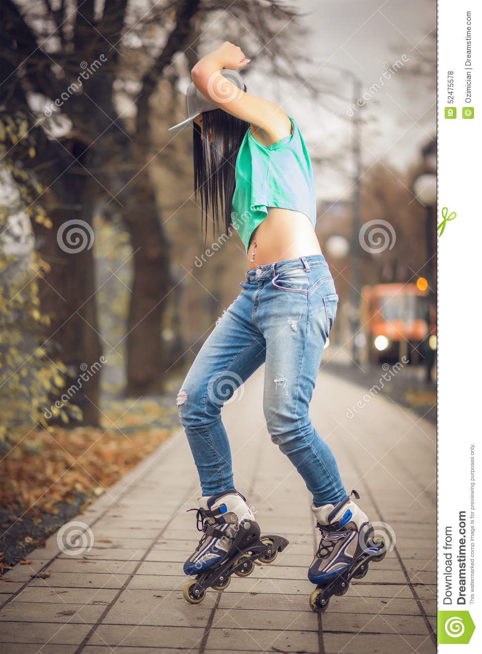 Woman Is Having A Fun In Park On Roller Skates Stock Photo