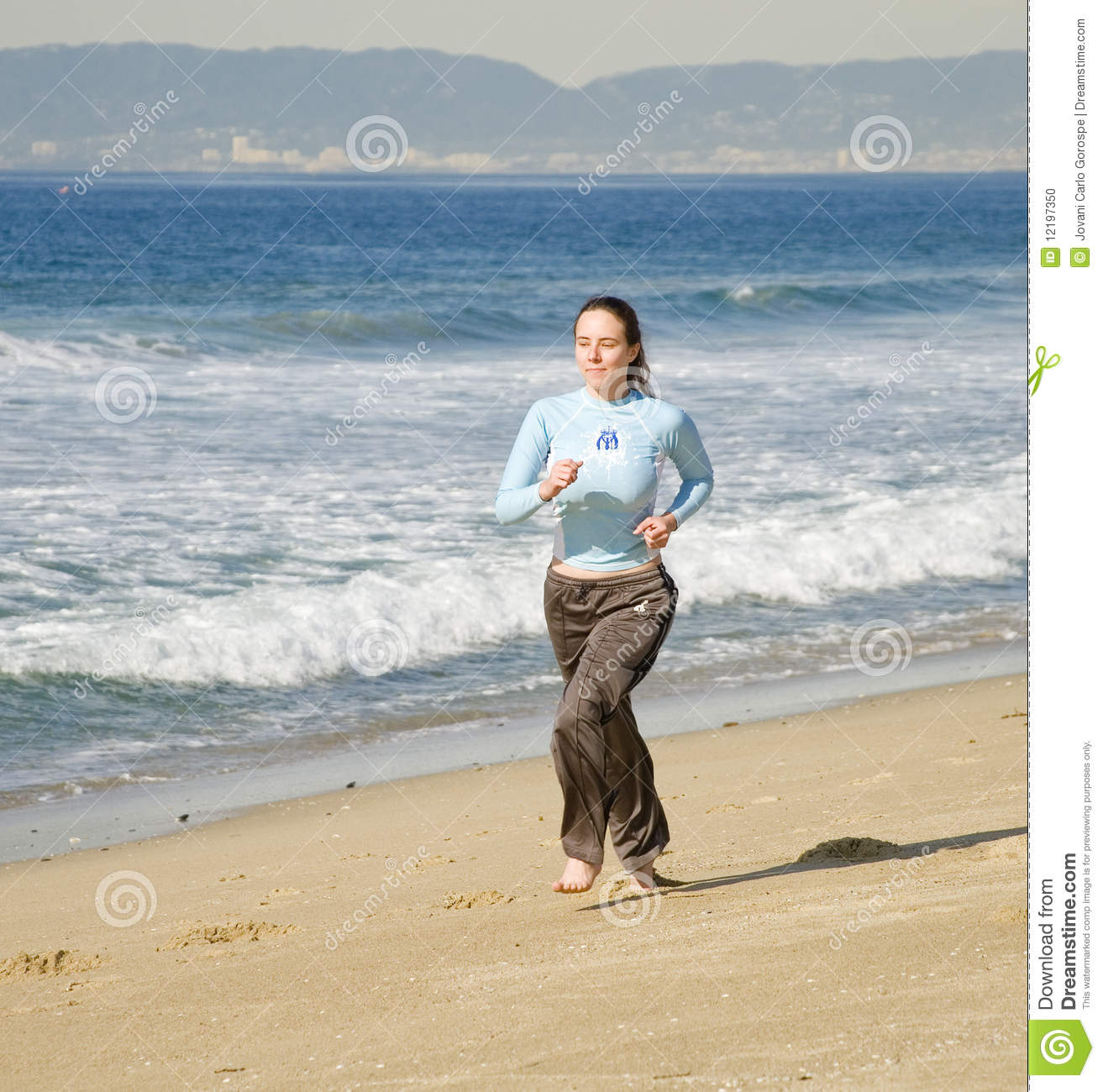 Girl Running at the Beach