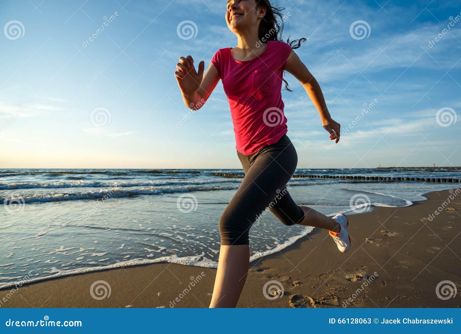 Girl Running On Beach Stock Photo - Image: 66128063 Girl Running On Beach