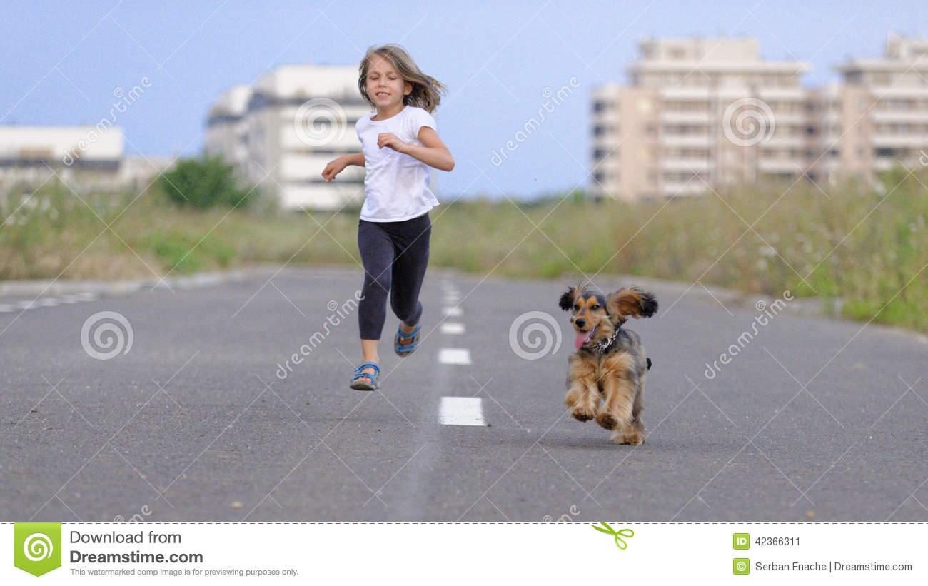 girl running with her dog stock photo image 42366311
