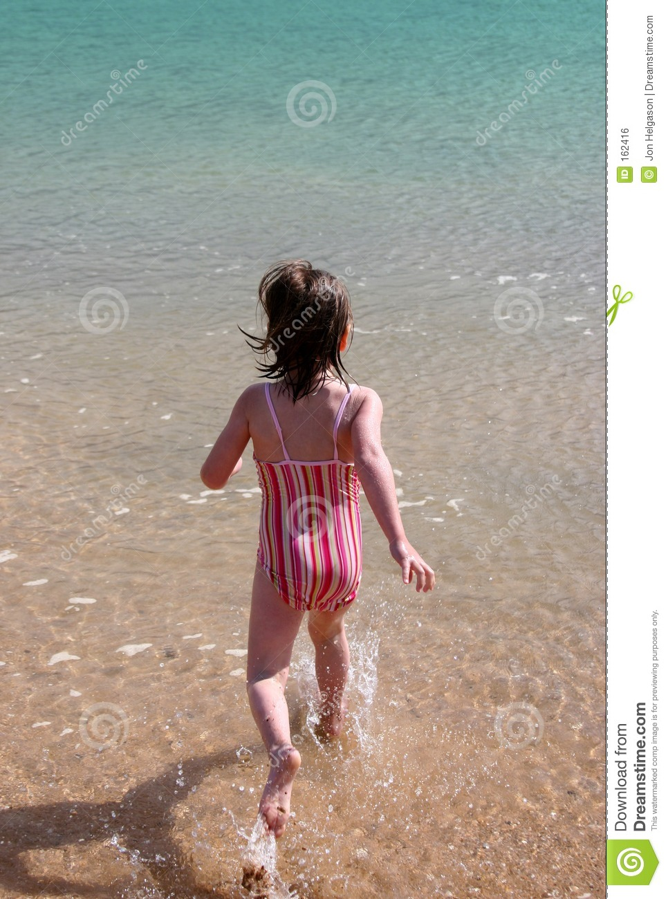 Girl running into the water