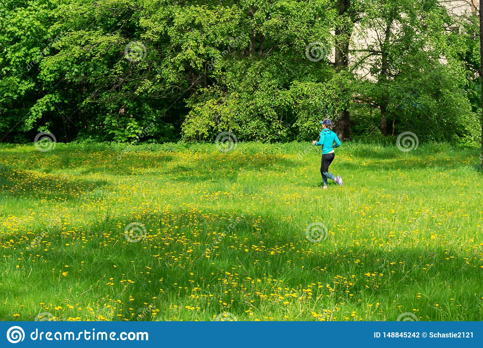 Girl runs along the trail, summer sunny day.