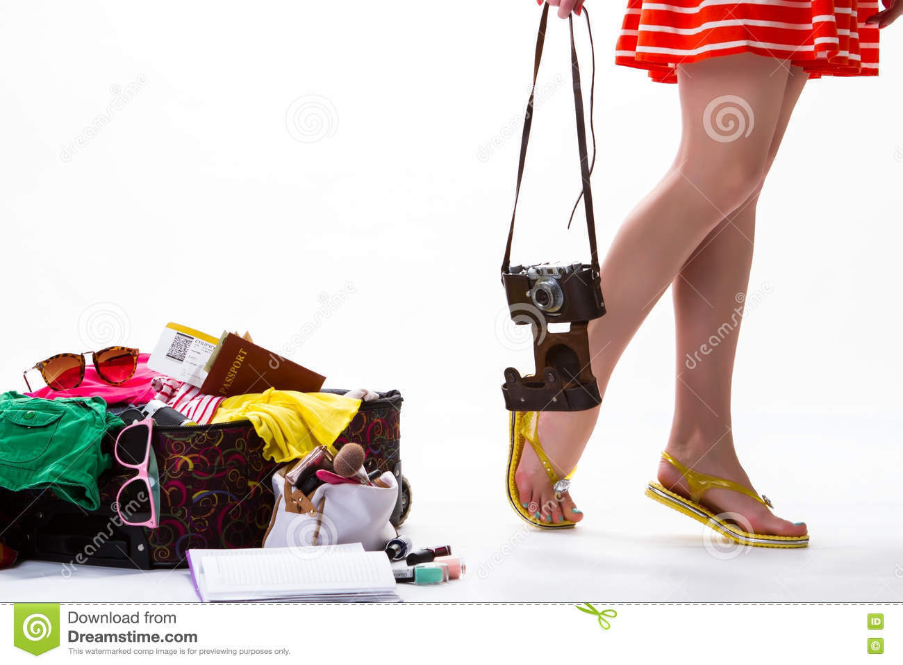 Girl s legs and open suitcase.