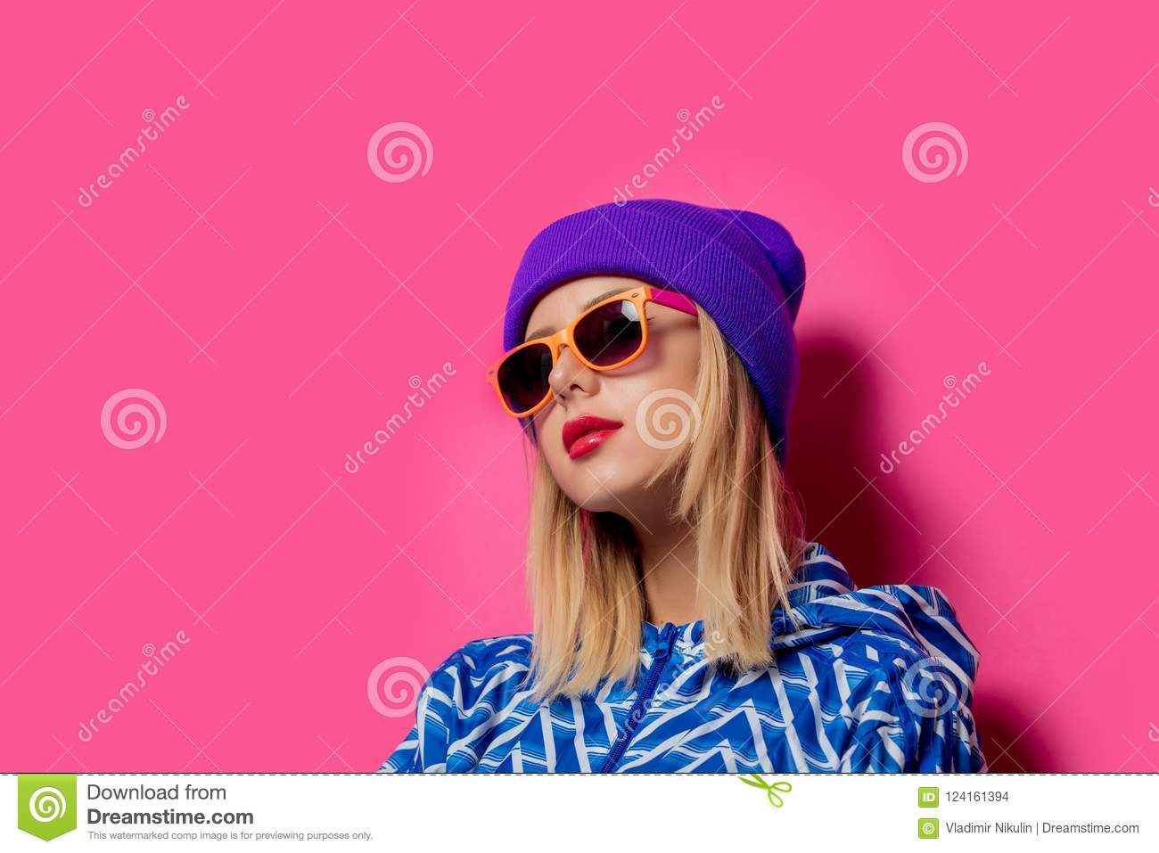 Girl in 90s sports jacket and hat with sunglasses