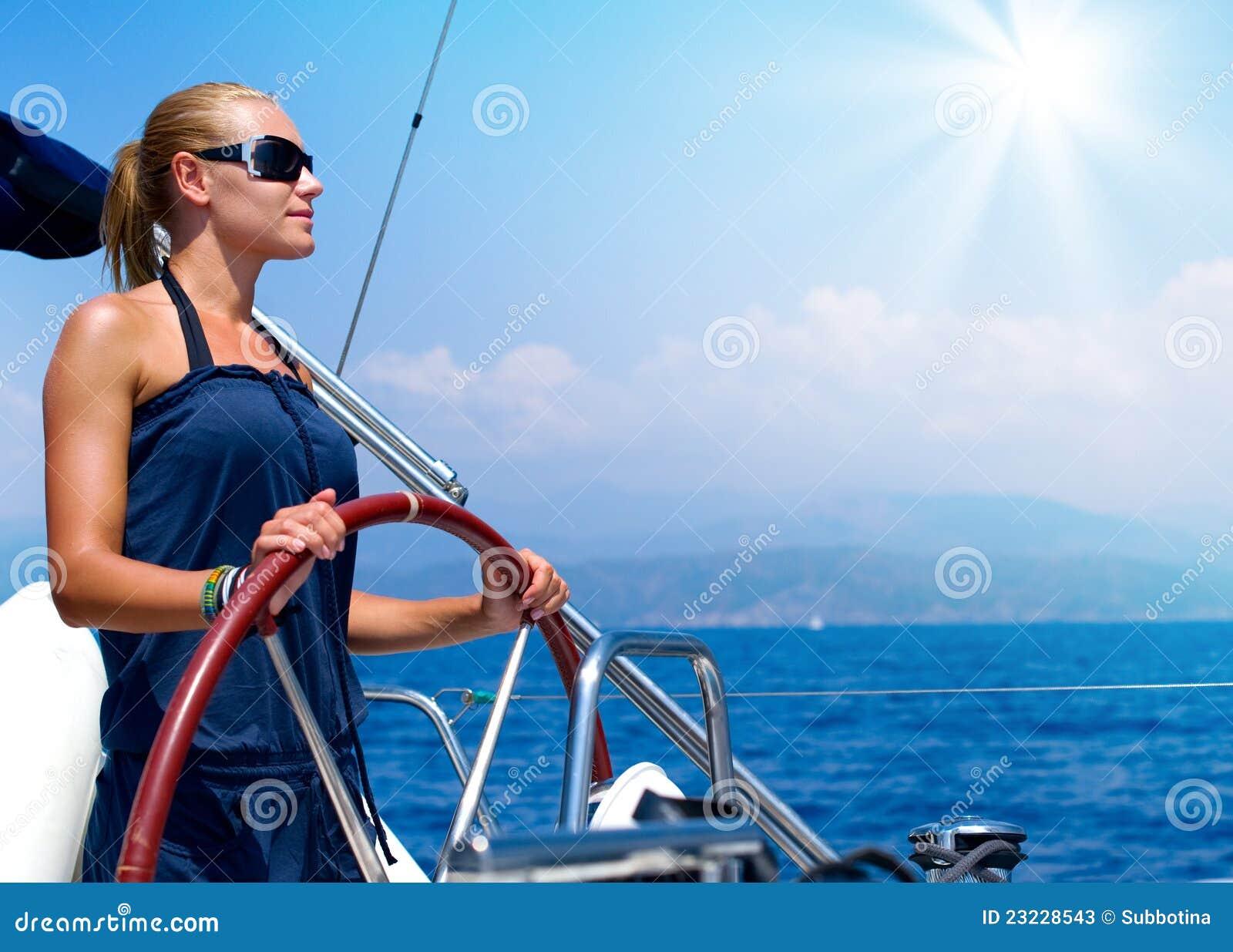 Girl Sailing A Sailboat Stock Photos - Image: 23228543