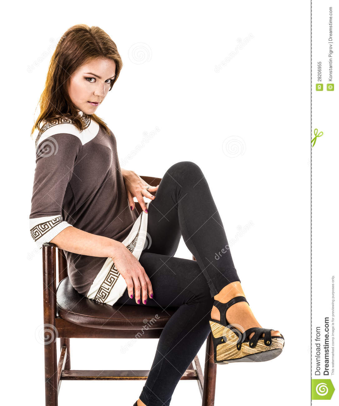 The girl in sandals is sitting on an old wooden armchair for Sitting in armchair