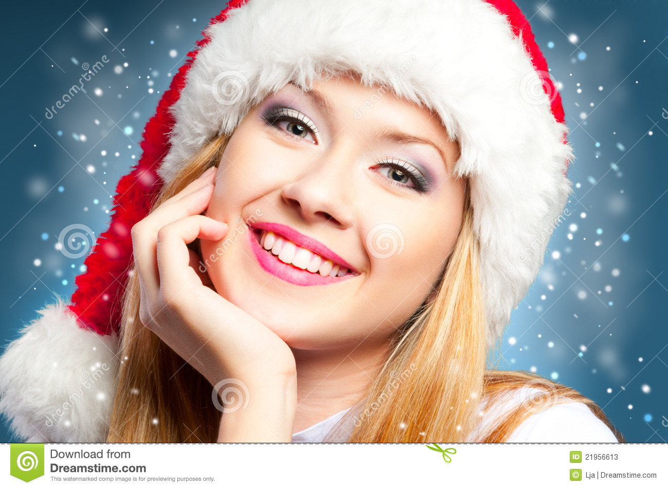 Red background Christmas girl in santa hat. Girl in santa hat portrait, red background Christmas girl in santa hat. Red background Christmas girl in santa hat. Red background Happy smiling girl with Santa hat with a phone. On a light background. Studio photography Girl with santa hat and shiny disco ball.