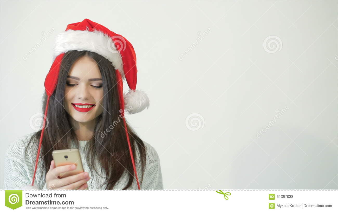 7b864f1023a0e Girl In Santa Hat Using A Smartphone Stock Footage - Video of present