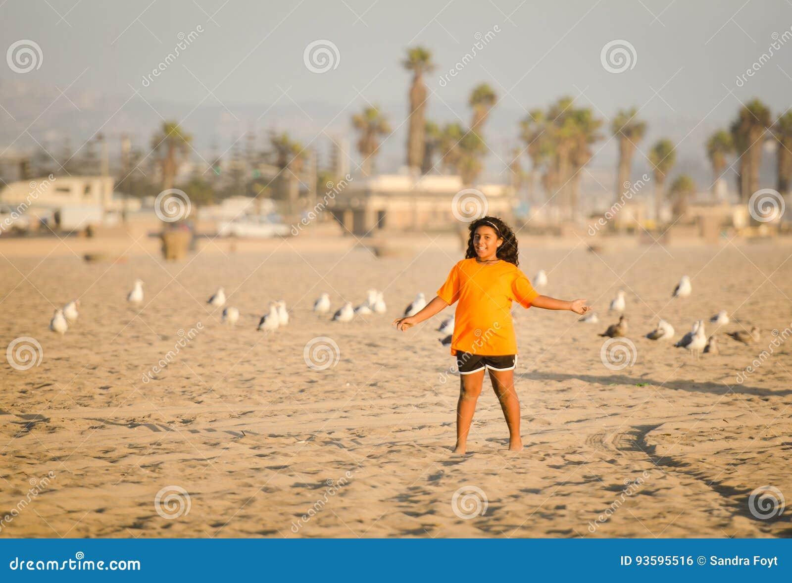 Girl and Seagulls - Huntington Beach, -California
