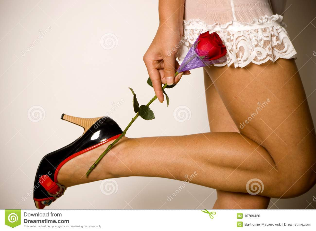 Постер Girl in sexy lingerie holding rose, плакат.